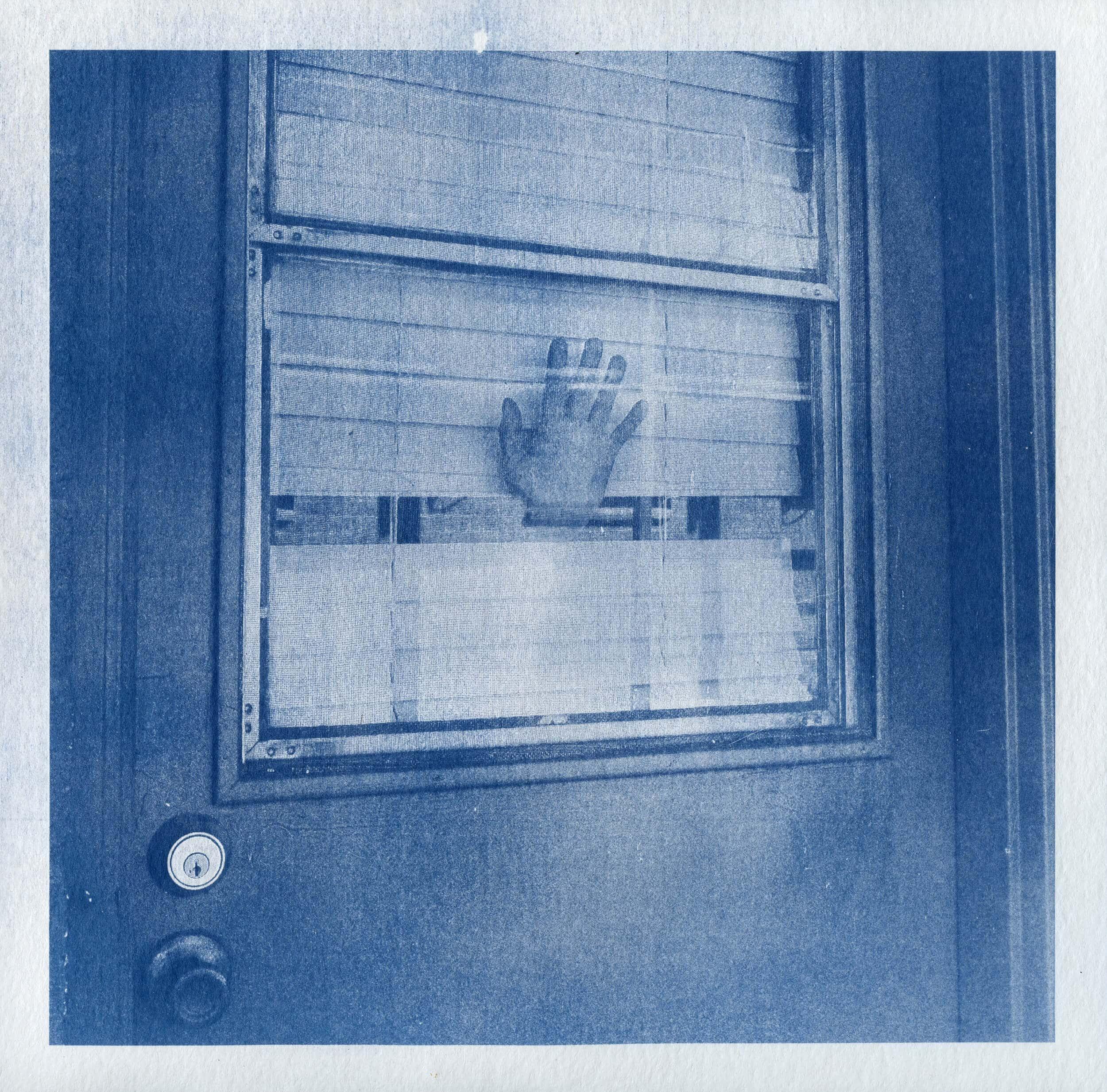 Hand in Window