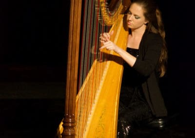Photo of Yvonne Cox playing harp