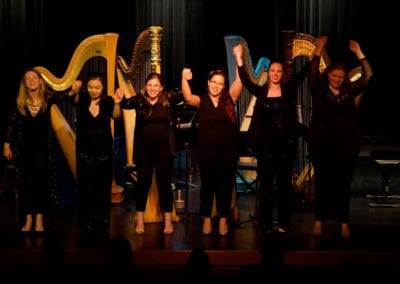 Photo of Harpists on stage