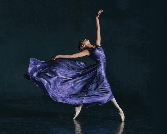 Ballerina in purple silk dress